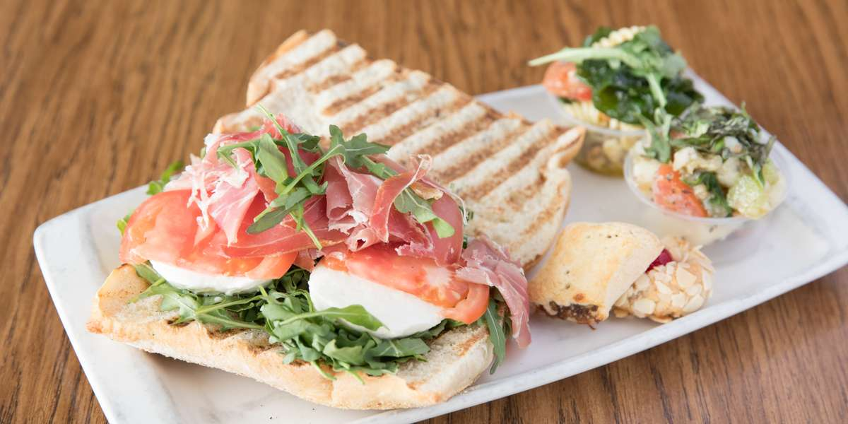 We're an authentic Italian deli & market boasting fine imported and domestic meats & cheeses, fresh grilled vegetables, olives, salads, sandwiches, entrees, and breads. Let us deliver one of our classic entrees like lasagna, Parmigiana, or stuffed peppers right to your office.  - Bonta