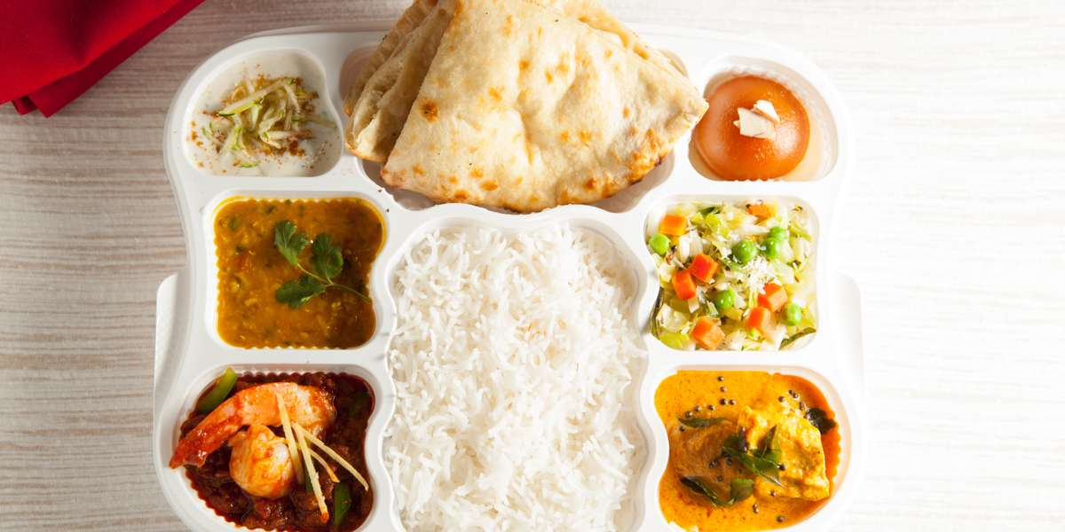 """Finding a complete meal can be one tall order, but with us it doesn't have to be! We serve up traditional Indian """"thaali""""; convenient lunchbox-style meals made up of entrees, sides, and desserts that all come together in flavorful harmony. - Thaali2go"""
