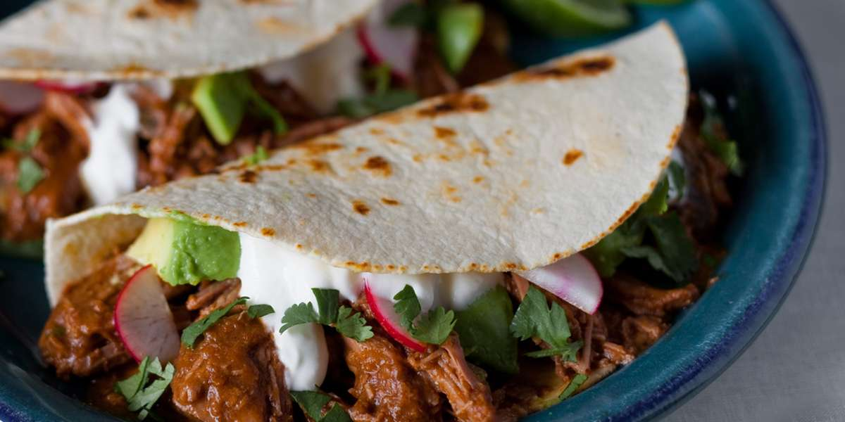 We offer Mexican fare with a fun twist. Whether you try our tacos, burritos, or quesadillas, you'll find exciting, edgy ingredients in all of our dishes. Give us a try and experience the exciting flavors of Mexico.  - La Botana Tacos