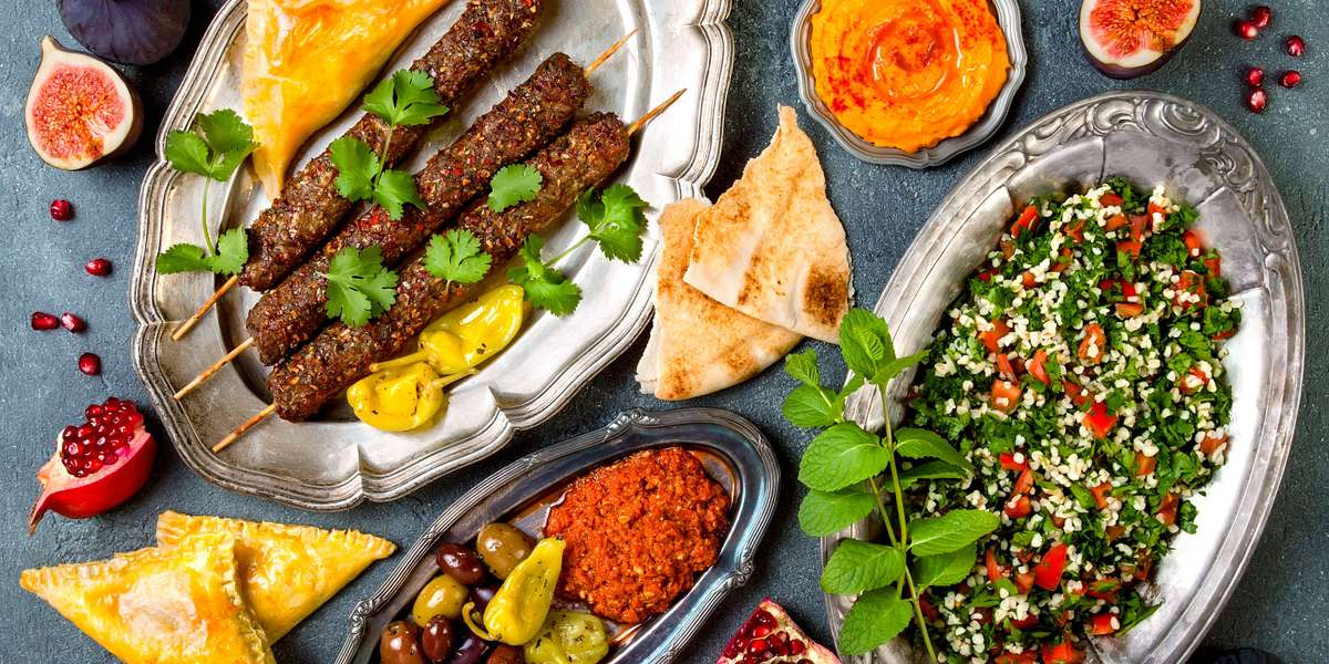 We've been wrapping up your hunger in one fell swoop since 1997! Our wraps are packed with the Mediterranean flavors you love: crisp falafel, marinated lamb, minced kofta, and much more. Pair with creamy hummus and smoky baba ghanoush for a meal your guests won't be able to resist. - Mediterranean Wraps