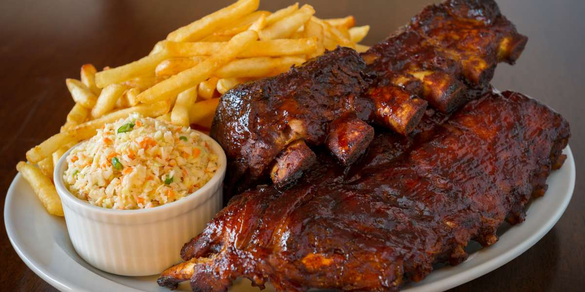 Are you looking for some darn good BBQ in Uptown Houston? Look no further! We have finger-licking meats and classic Texas-style sides and desserts to tame any cowboy's appetite. We even have large catering packages because everything is bigger in Texas. - Stockyard Bar-B-Q