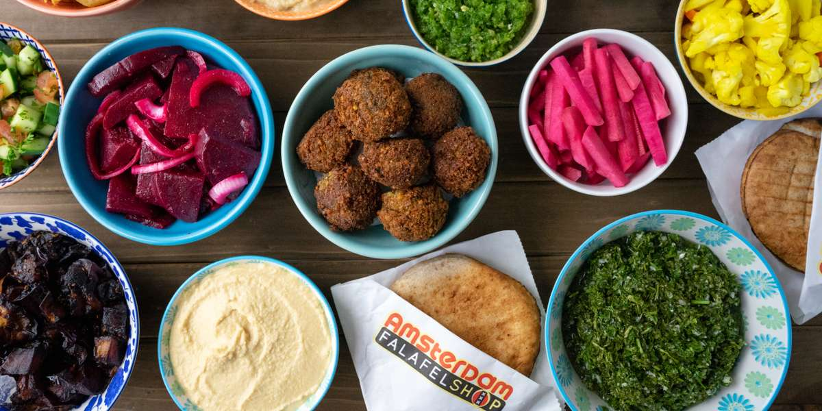 Take the trip and try our build-your-own pita sandwich packages, at the level that fits your appetite and budget, and experience our famous Amsterdam-style falafel. Crunchy, moist, and accompanied by all the toppings you could wish for...we're the perfect solution to your office lunch needs. - Amsterdam Falafelshop