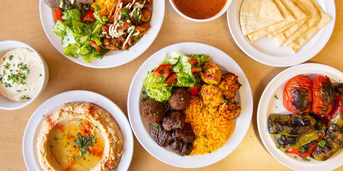 It's never been easier to order a Middle Eastern feast for your office. Just pick a protein and we'll do the rest. Choose between tender chicken or crispy falafel and enjoy it with salad, rice, hummus, and more. Need a treat? Our flaky baklava won't disappoint. Customers say we come highly recommended. - The Shawarma Factory